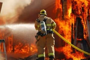 fire fighter in front of large fire | campbell county chamber of commerce