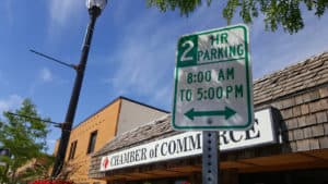 2 hour parking sign in front of campbell county chamber of commerce building
