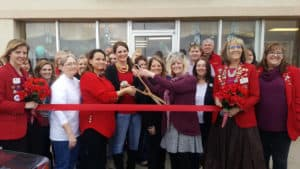 red daisy ribbon cutting