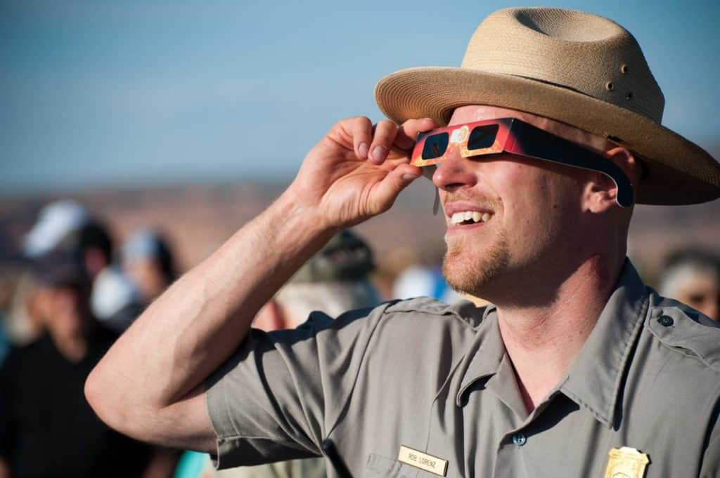 solar eclipse glasses on park ranger