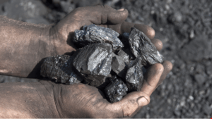 dirty hands holding coal