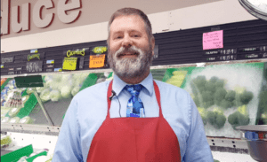 supermarket owner with red apron | campbell county chamber of commerce