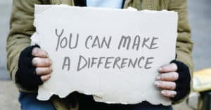 you can make a difference cardboard sign