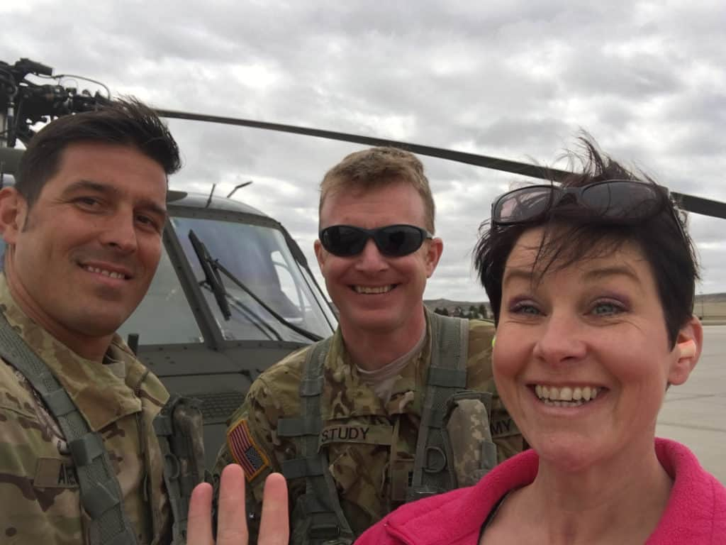 tracy in front of blackhawk helicopter | campbell county chamber of commerce