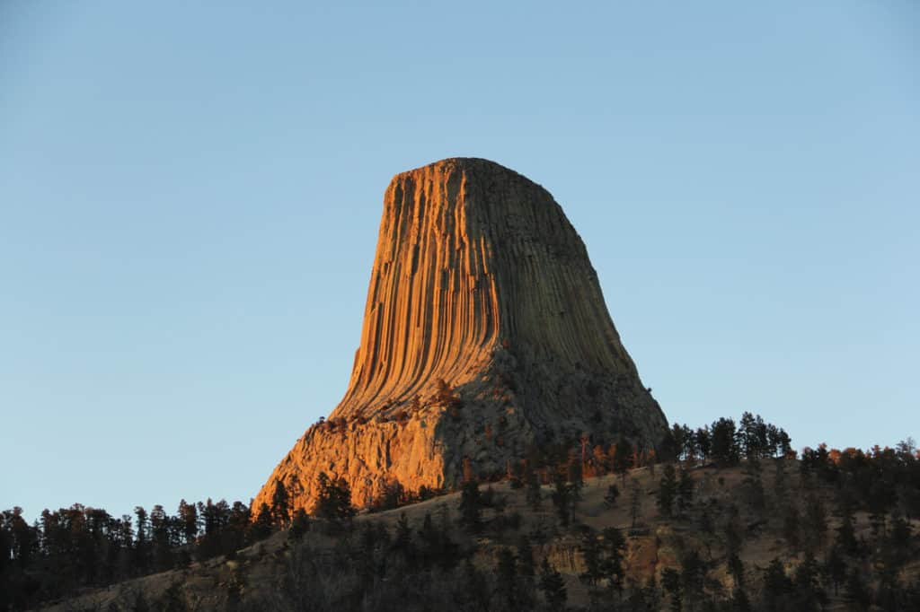 devils tower at sun set