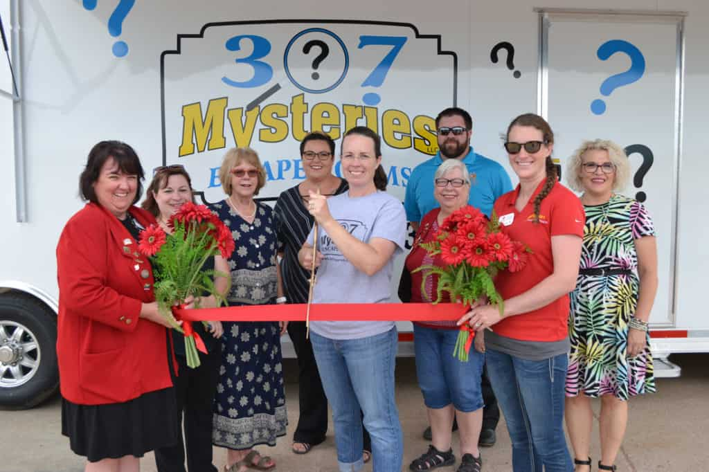 307 mysteries ribbon cutting