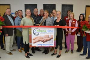 helping hand ribbon cutting
